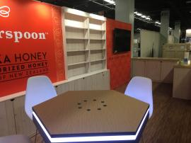 Custom Wood Exhibit with Shelves, Cabinets, SEG Graphics, Lighting, and MOD-1450 Charging Table with Graphics